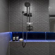 LED lights shining on charcoal glass splashback tiles angle, bathroom, floor, flooring, plumbing fixture, room, shower, tap, tile, toilet, wall, black, gray