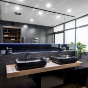 Multi-purpose feature  in this apartment ensuite a countertop, interior design, kitchen, black, white