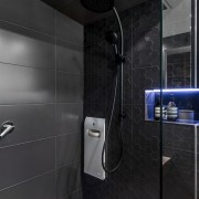 On this project by designer Kim Duffin, a architecture, bathroom, floor, interior design, plumbing fixture, room, tile, black