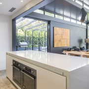 This kitchen is positioned so have sightlines to countertop, daylighting, interior design, kitchen, real estate, window, gray