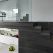 This modern new kitchen, designed by architect Julie architecture, floor, flooring, furniture, glass, house, interior design, product design, table, wood, gray, black