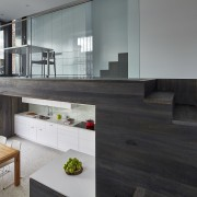 This modern new kitchen, designed by architect Julie architecture, floor, flooring, furniture, house, interior design, table, wood, gray, black