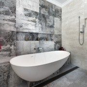 Three types of large-format tile feature in this architecture, bathroom, floor, flooring, interior design, room, tile, wall, gray