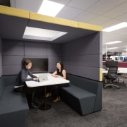 A collaborative space in the medium noise level desk, furniture, interior design, office, product design, black, gray