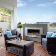 A modern gas fire keeps the deck area home, interior design, living room, penthouse apartment, property, real estate, gray