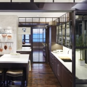 This fully functioning kitchen sits behind the homes countertop, interior design, kitchen, black, white