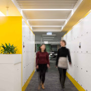 The work stations and most meeting rooms are architecture, ceiling, yellow, gray