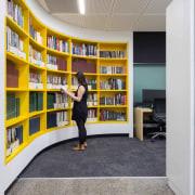 Resene Half Merino, a milky white, provides the bookcase, furniture, institution, library, public library, shelf, shelving, gray