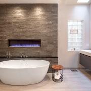 Stone-look tiles, an enclosed gas fire that changes bathroom, countertop, floor, flooring, home, interior design, plumbing fixture, room, sink, tap, tile, wall, gray