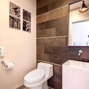 Metal strips inlaid between every second row of bathroom, bathroom accessory, bidet, ceramic, floor, home, interior design, plumbing fixture, product design, room, sink, tap, tile, toilet, wall, white, brown