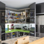 Kitchen designer Chris Moore introduced a generous corner countertop, interior design, kitchen, gray, black
