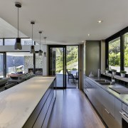 For the kitchen in this family home, the architecture, house, interior design, living room, real estate, window, gray