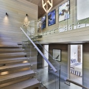 A basement level lobby with a grand staircase architecture, ceiling, daylighting, floor, handrail, interior design, lobby, stairs, tourist attraction, wood, gray