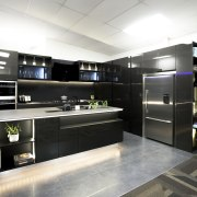 Gleaming cabinet faces, durable stone countertops and plenty interior design, kitchen, white, black
