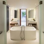 This ensuite bathroom features double wall hung vanities bathroom, bathroom accessory, interior design, plumbing fixture, product, product design, room, sink, orange