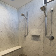 Double shower-heads and a foot ledge feature in bathroom, ceiling, daylighting, floor, interior design, plumbing fixture, room, shower, tap, tile, wall, gray, brown
