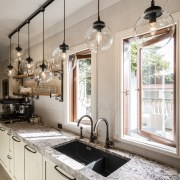 A rustic bagged-brick tile splashback is combined with cabinetry, countertop, cuisine classique, home, interior design, kitchen, sink, window, gray