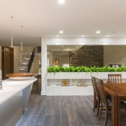 Plants on a low dividing wall add a ceiling, countertop, interior design, kitchen, real estate, room, gray, brown