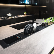 While refined and glamorous, this modern kitchen is product design, technology, black, white