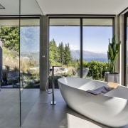 This sculptural tub sits in its own glass architecture, house, interior design, real estate, window, gray