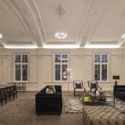 On this adaptive reuse project, two historic buildings ceiling, daylighting, estate, interior design, living room, lobby, real estate, room, orange, brown