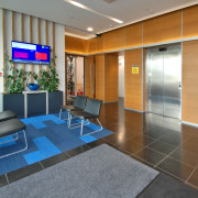Built in 2008, the NZI Centre achieved a interior design, lobby, office, real estate, gray