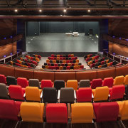 :The initial brief called for a traditional theatre auditorium, concert hall, performing arts center, stage, theatre, red