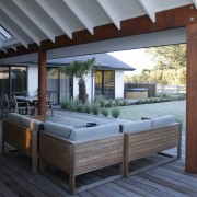 On this future-proofed home, the deck is on deck, house, interior design, outdoor structure, real estate, roof, gray, black