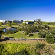 Highbrook Business Park represents a world-class, mixed-use business bird's eye view, city, estate, grass, land lot, landscape, real estate, reservoir, residential area, rural area, sky, suburb, tree, water, brown