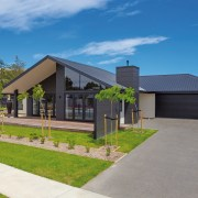Sporting contemporary black and white cladding, this Edison cottage, elevation, estate, facade, home, house, land lot, landscape, property, real estate, residential area, roof, sky, suburb, teal