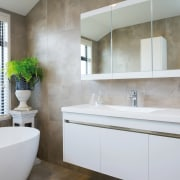 The main bathroom in this GJ Gardner showhome bathroom, bathroom accessory, bathroom cabinet, home, interior design, room, sink, white, gray