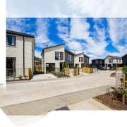 This Housing New Zealand Waterview development has achieved architecture, estate, facade, home, house, mixed use, neighbourhood, property, real estate, residential area, sky, white