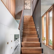 A suspended staircase helps screen the kitchen and architecture, daylighting, floor, handrail, hardwood, home, house, interior design, stairs, wall, wood, gray
