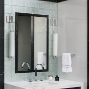 This vanity is backdropped by silver-backed tiles  bathroom, bathroom accessory, bathroom cabinet, glass, interior design, gray