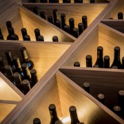 On this custom wine storage and display unit lighting, wine cellar, winery, wood, black, brown