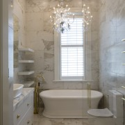 The combination of a high ceiling, tiled walls, bathroom, ceiling, floor, home, interior design, plumbing fixture, room, tile, gray