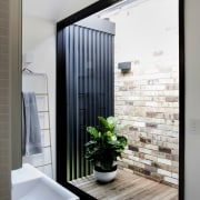 Natural light floods into this ensuite from one architecture, home, house, interior design, room, window, gray, white