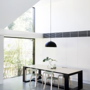 Oversized windows flood light into this dining, living architecture, chair, coffee table, furniture, house, interior design, living room, product design, table, white