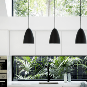 This long, low window acts as a splashback home, house, interior design, lamp, light fixture, lighting, lighting accessory, living room, product design, white