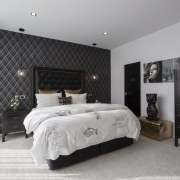 The use of black tones and lustrous hints bed frame, bedroom, ceiling, floor, furniture, home, interior design, room, wall, gray, black