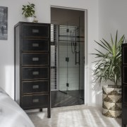 The tallboy in this bedroom picks up on furniture, gray