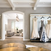 For the new House of Grace Chen base, boutique, bridal clothing, bride, ceiling, dress, floor, flooring, gown, home, interior design, lobby, room, wedding, wedding dress, gray