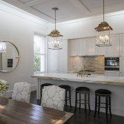 As part of a whole-house renovation, this kitchen ceiling, countertop, cuisine classique, dining room, floor, home, interior design, kitchen, real estate, room, table, gray