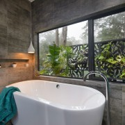 Its a jungle sometimes  the tropical garden architecture, bathroom, bathtub, estate, home, house, interior design, property, real estate, room, window, black, gray