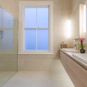 Under-vanity lights create a subtle wash of light bathroom, interior design, real estate, room, window, gray