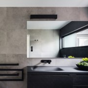 Add a dark, rich element with a black architecture, countertop, interior design, kitchen, sink, wall, gray, black