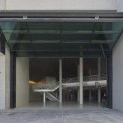 With the bi-folding Porte Pliante open up, the architecture, door, facade, structure, gray, black