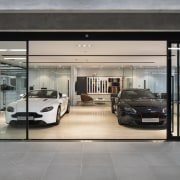 Pre-owned vehicles are displayed on the upper showroom automotive design, bmw, building, car, car dealership, door, executive car, floor, glass, interior design, luxury vehicle, motor vehicle, vehicle, vehicle door, gray