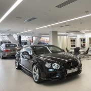 Specially designed areas of the showrooms at the automotive design, automotive exterior, automotive wheel system, bentley, bentley continental flying spur, bentley continental gt, bentley continental gtc, bentley continental supersports, building, car, car dealership, executive car, family car, luxury vehicle, mid size car, motor vehicle, parking, performance car, personal luxury car, rim, technology, vehicle, wheel, gray