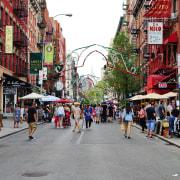 Designer boutiques, high-end restaurants and art galleries make city, crowd, downtown, market, marketplace, neighbourhood, pedestrian, public space, road, shopping, street, tourism, town, urban area, gray